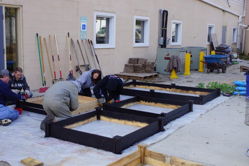 Porticos team members working in the CAARE garden.