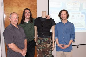 Greg Patterson with David, PJ, and the original Porticool vest mannequin.